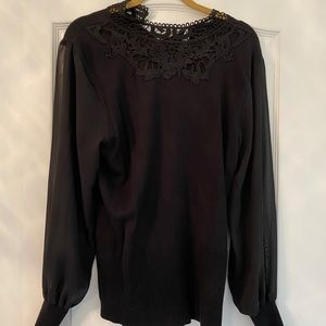 Black sweater with sheer sleeves